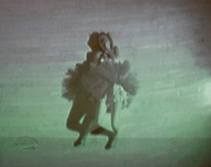 Pam Gregory, performer.  Image projected on wall via surveillance camera